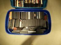 Two totes full of dvds