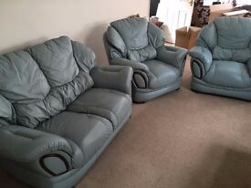 Three piece leather suite (two seater and x 2 armchairs)