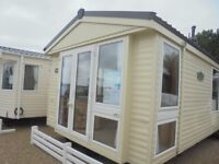 Cheap static caravan for sale in Talybont, North Wales. Includes 2018 site fees!