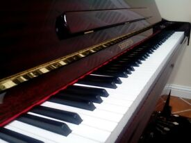 UPRIGHT PIANO-Beautiful Rich Mahogany- 4 years old. Fantastic condition.