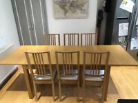 Extending dining table oak IKEA BJURSTA and six borje chairs seats 6 8 10 excellent condition
