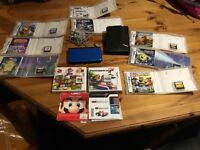 Nintendo 3ds xl bundle. Blue console with 11 games and accessories.