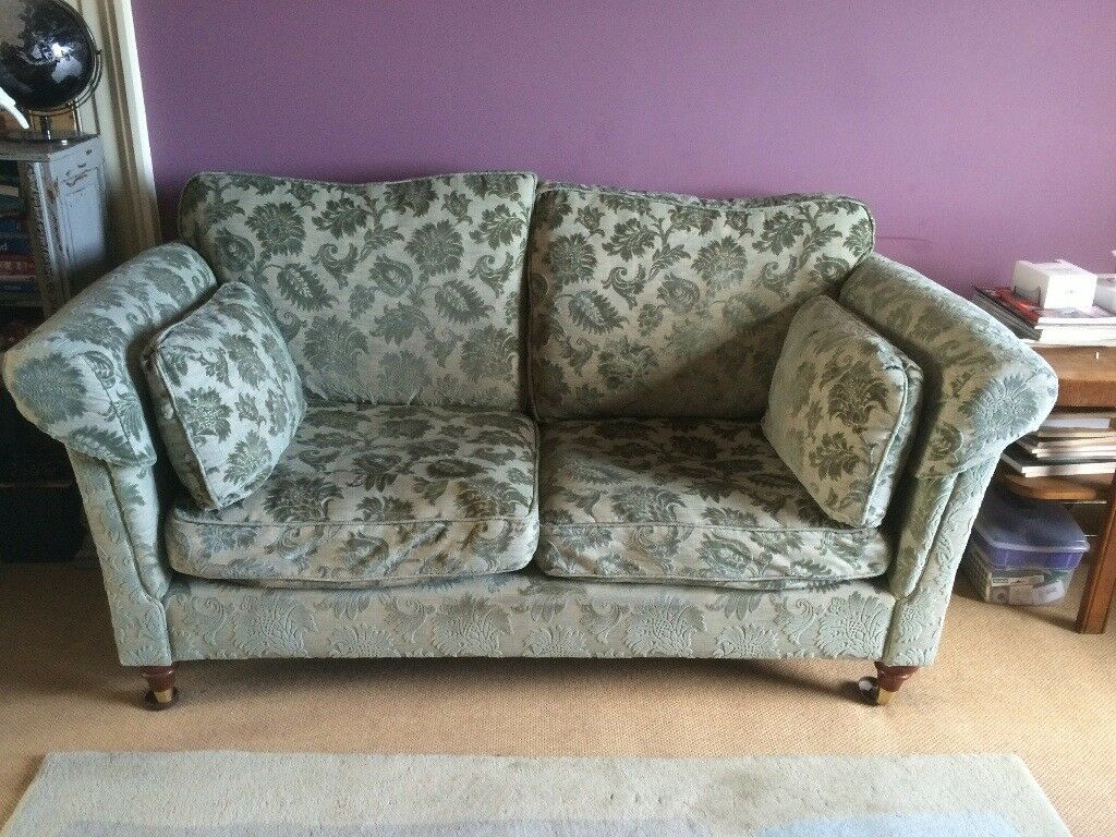 Solid handmade settee upholstered in a moss green textured fabric. Exceptionally comfortable.