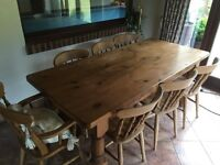 Solid pine farmhouse style table and chairs. Seats 8
