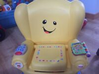 Kids activity chair ,like new would suit 1-2 yrs old .plays music and learns
