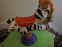 Fisher price jump and spin zebra.