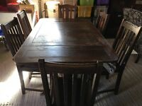 Dining room table and six chairs.