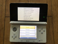 Nintendo 3DS plus charger, charging base box and 3 free DS games included