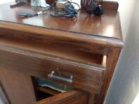 A dark solid wood antique gentleman cabinet in excellent condition