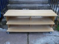Ikea pine coloured tv unit /bench on wheels