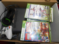 xbox 360 elite, 120 gb hard drive, head phone, 8 games, controller.