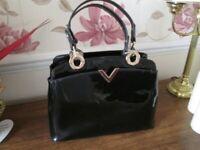 Smart black patent handbag