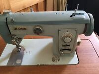 Jones vintage sewing machine with built in table