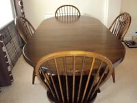 Real Wood Dining Room Table,4 Carvers and Cabinet
