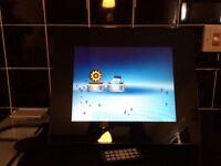 BNIB LCD digital photo frame. Plays movies, videos and music