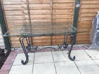 Glass table with metal base for garden