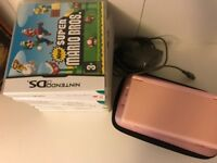 Pink Nintendo DS Lite with six games