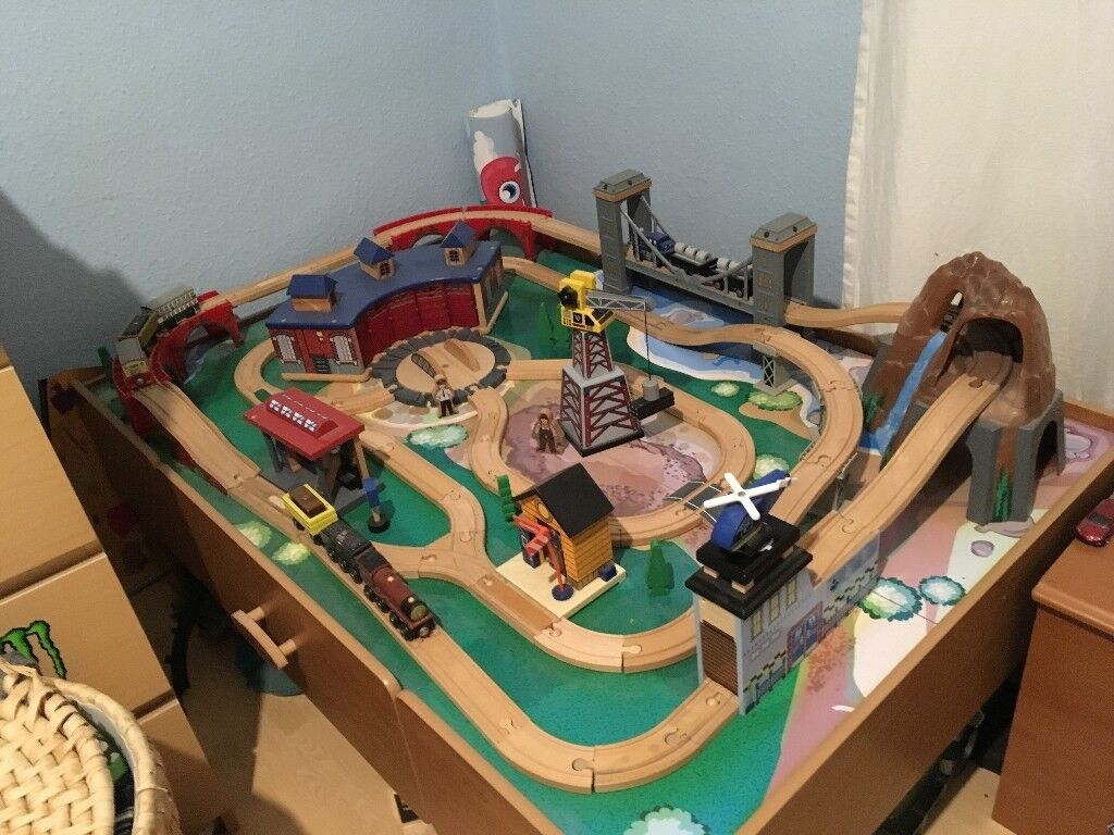 Wooden train set with sounds and lights