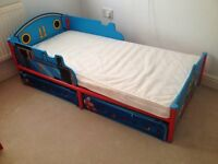 Thomas toddler bed & matress with storage compartments under bed, curtains & lampshade.