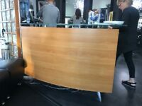 Wooden reception desk with glass top