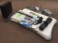 Nintendo WII plus WII fit board and accessories