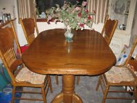 Yew dining table and 8 chairs. Chairs are upholstered in a beigescript fabric. All in VGC