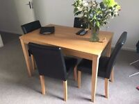4 seater dining table and chairs in great condition