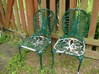 A pair of aluminium garden chairs
