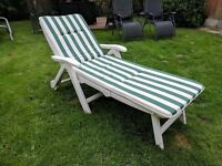 White sun lounger with top cushion