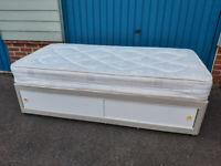 Single divan bed with slide storage