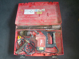 hilti te75 breaker/drill, heavy duty, 110 volt, variable speed, drills and chisels included.