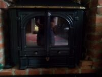 Wood burning stove with water boiler