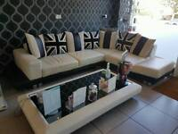 Corner leather sofa with coffee table
