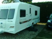 2012 Bailey Unicorn Cadiz, 4 berth, motor mover, tracker, end bathroom. Alde heating. Immaculate.