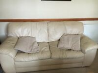 Two sofas cream leather. A three seater and a two seater.