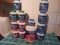 Job Lot of 13 Tubs of Tropical Fish food / flake and pellets . a bargain !!!!