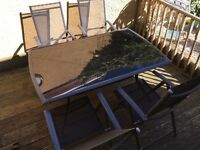 Garden table and 4 fold away chairs