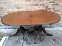 Extending pedestal legged mahogany dining table