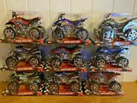 Friction Quad Bikes in display box different colours