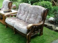 Cottage Suite, solid wood light oak. 2 seater settee. Matching table. Excellent condition. REDUCED