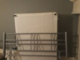 Double bed with metal headboard