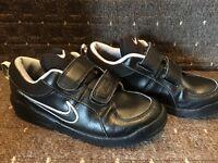 Kids black Nike trainers