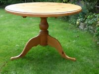 "Pine round pedestal dining table. 42"" (107cm) diameter. Good condition."