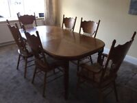 Fully extendable solid oak dining table + six chairs