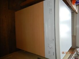 INTEGRATED DISHWASHER WITH BEECH DECOR PANEL, COULD ALSO BE FREESTANDING AS HAS A TOP IF REQUIRED