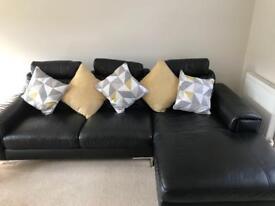 high gloss black lounge set and black leather sofa