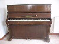 Piano free to good home.