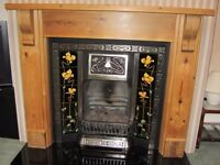 Period cast iron gas fire and pine surround
