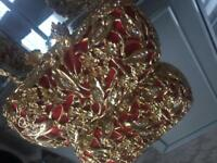 Gold and Red clutch bag