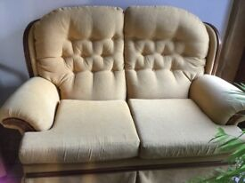 Pretty two seater button backed sofa in gold chenille.